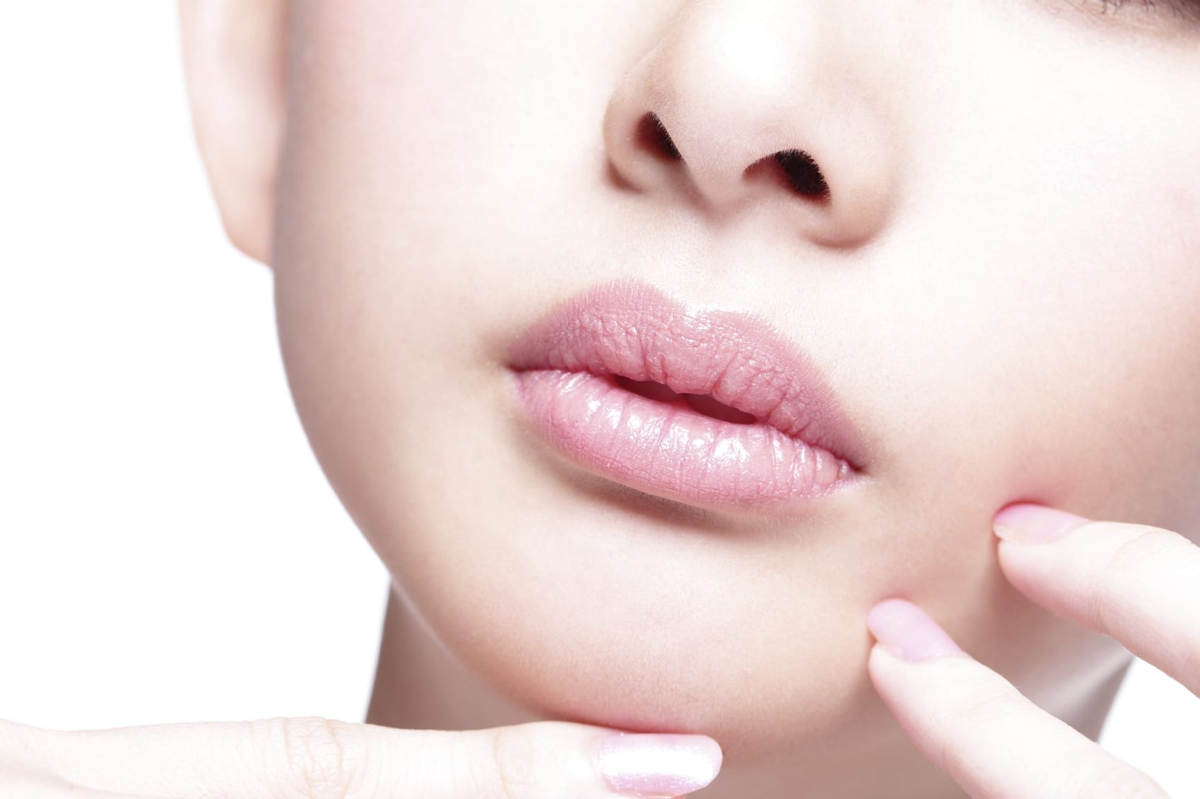 woman with plump lips and glowing skin